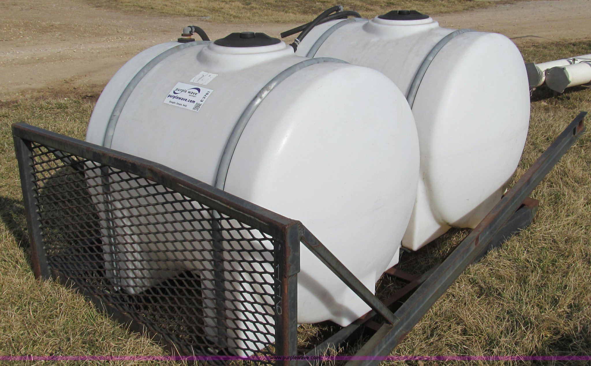2) front mounted tractor spray tanks | Item E3781 | SOLD! W