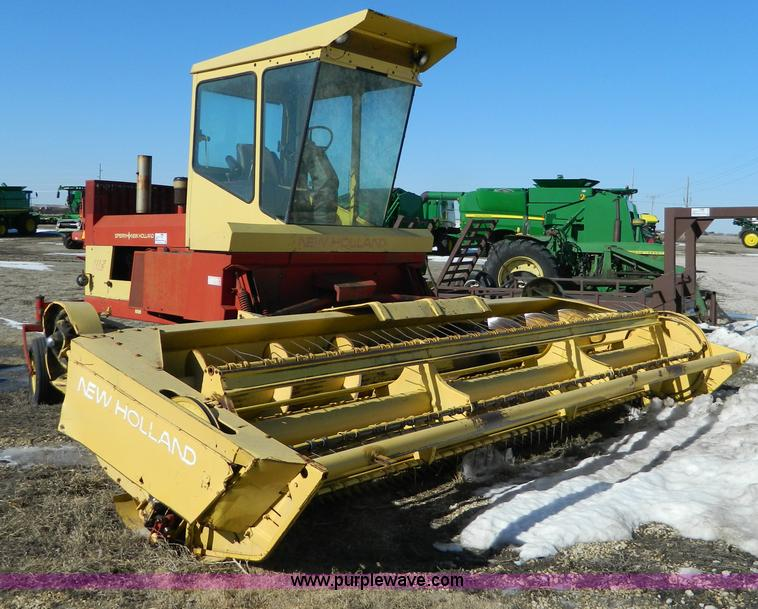 New Holland 1112 swather   Item G7745   SOLD! March 27 Ag Eq