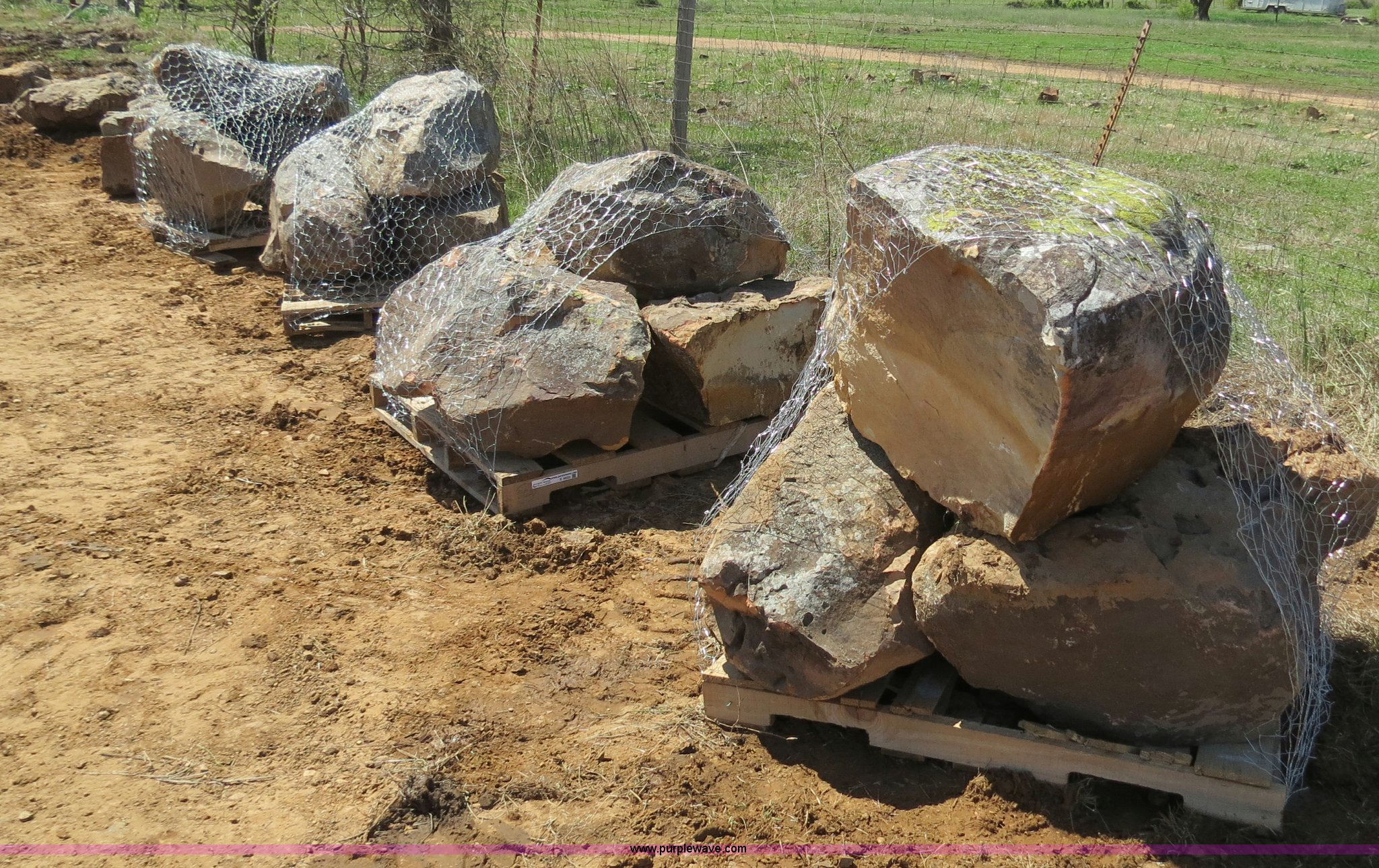 Approximately 24 ton natural stone mass landscaping boulders