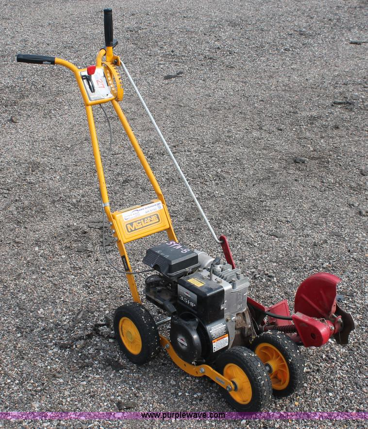 how to use a manual lawn edger