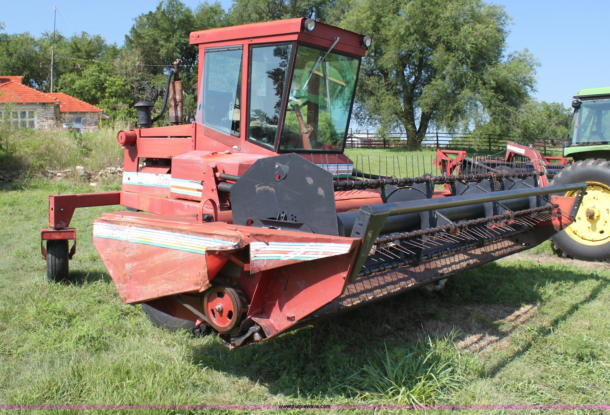 1990 MacDon 7000 self-propelled swather   Item G4030   SOLD!