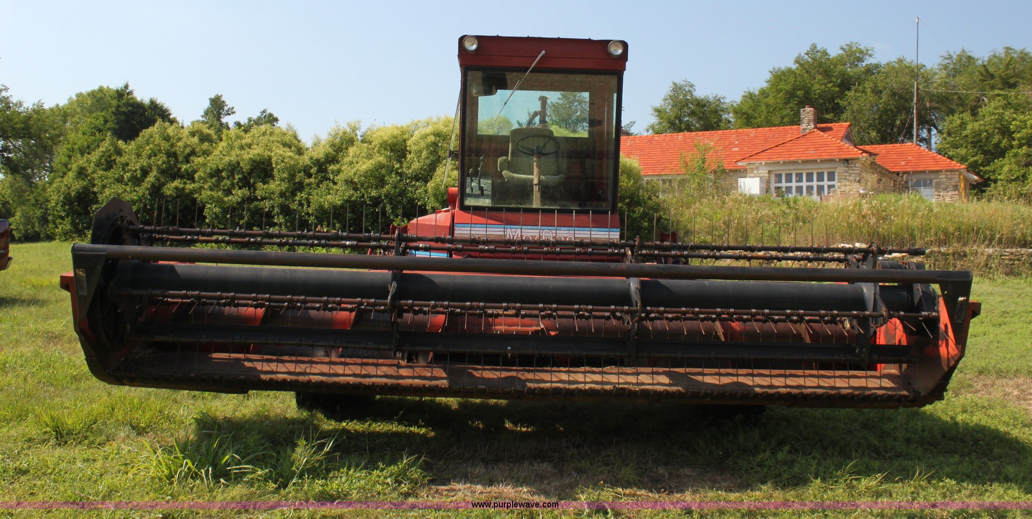 1990 MacDon 7000 self-propelled swather | Item G4030 | SOLD!