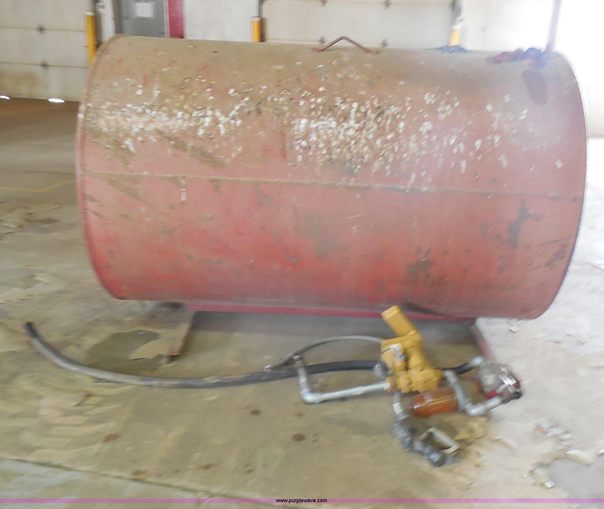 2) steel fuel tanks on stands | Item E5163 | SOLD! Septembe