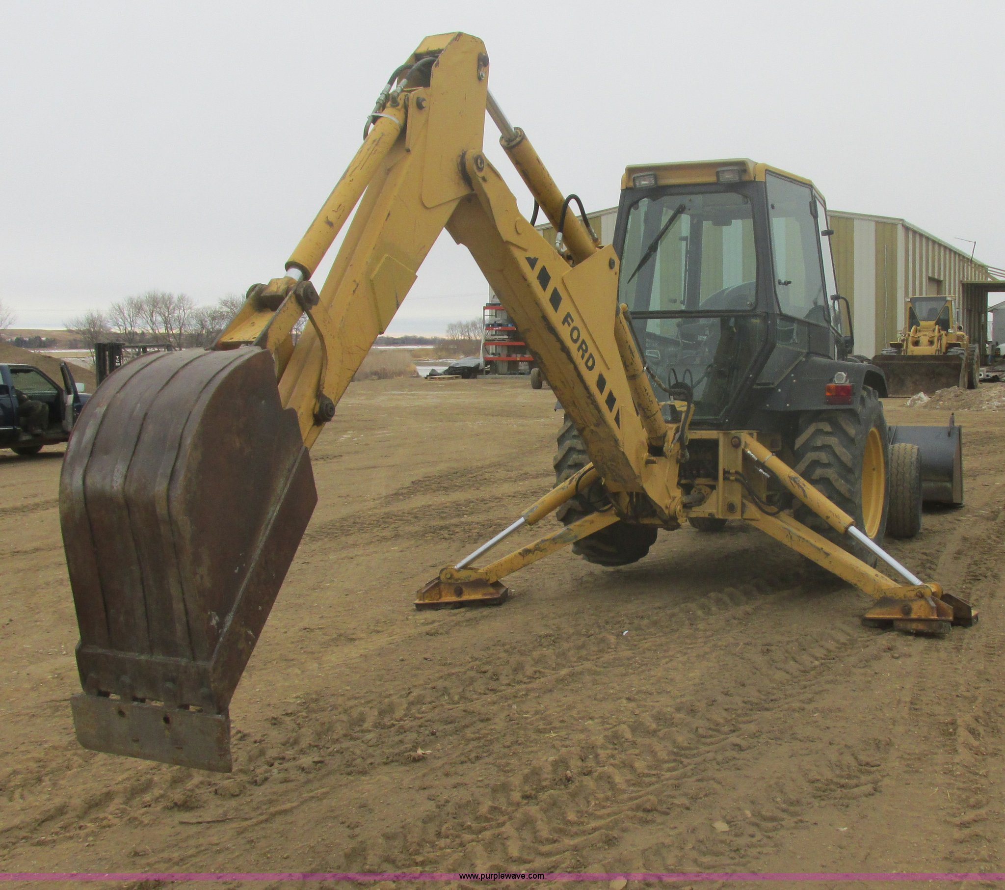 Ford 555D backhoe | Item E5272 | SOLD! February 13 Construct
