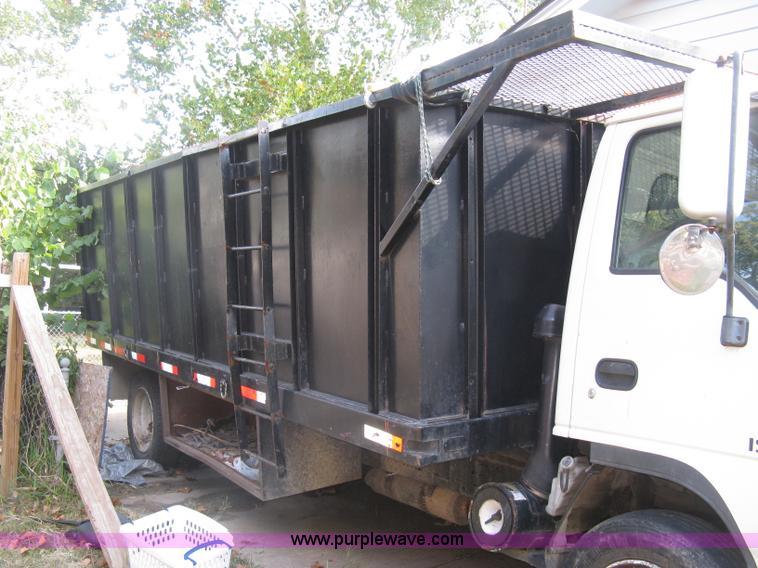 2001 Isuzu NQR flatbed dump truck | Item E7965 | SOLD! Octob