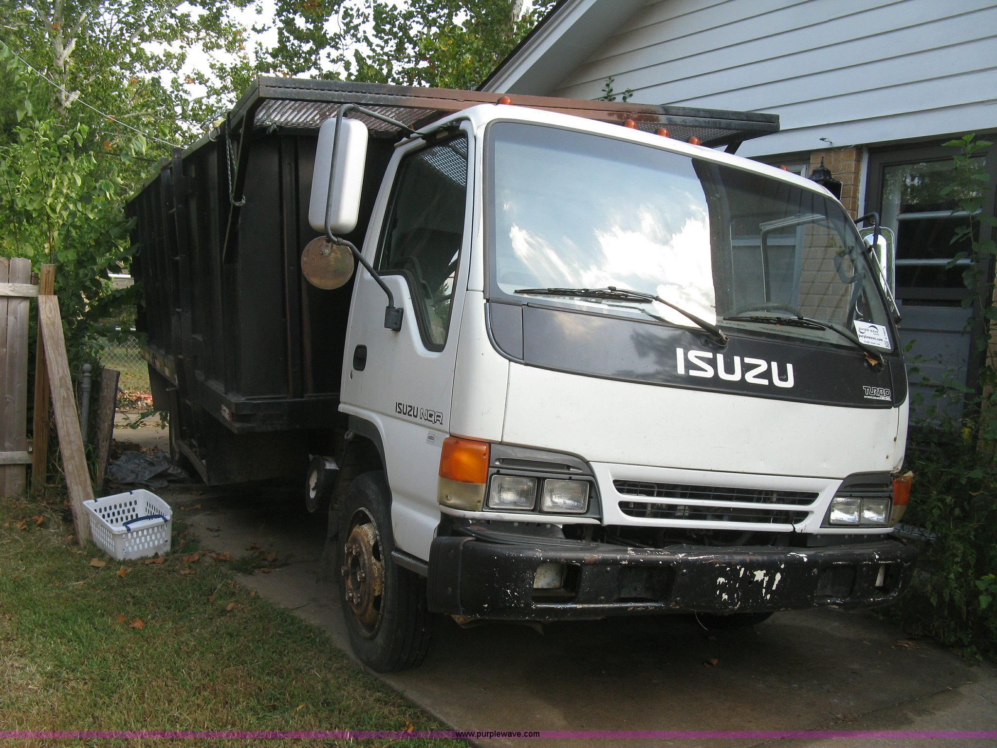 2001 isuzu nqr flatbed dump truck item e7965 sold octob