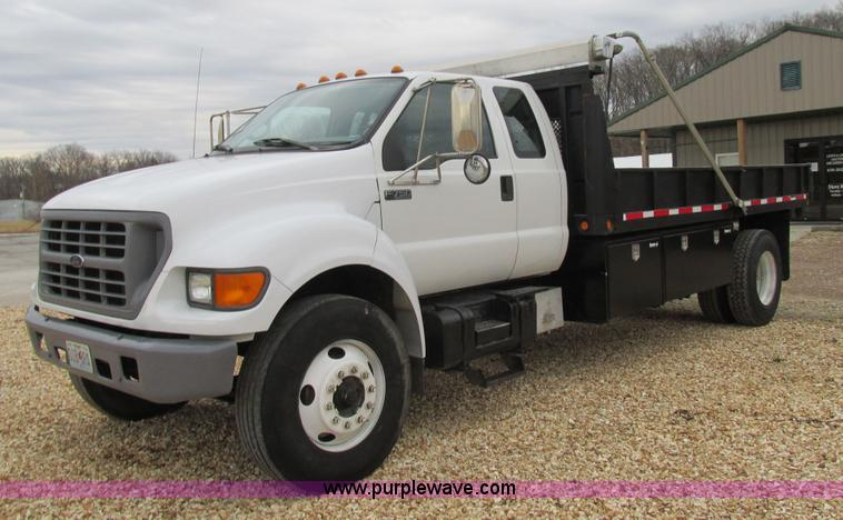 2000 Ford F750 Super Duty XL Ext. Cab flatbed dump truck | no-reserve auction on Wednesday ...