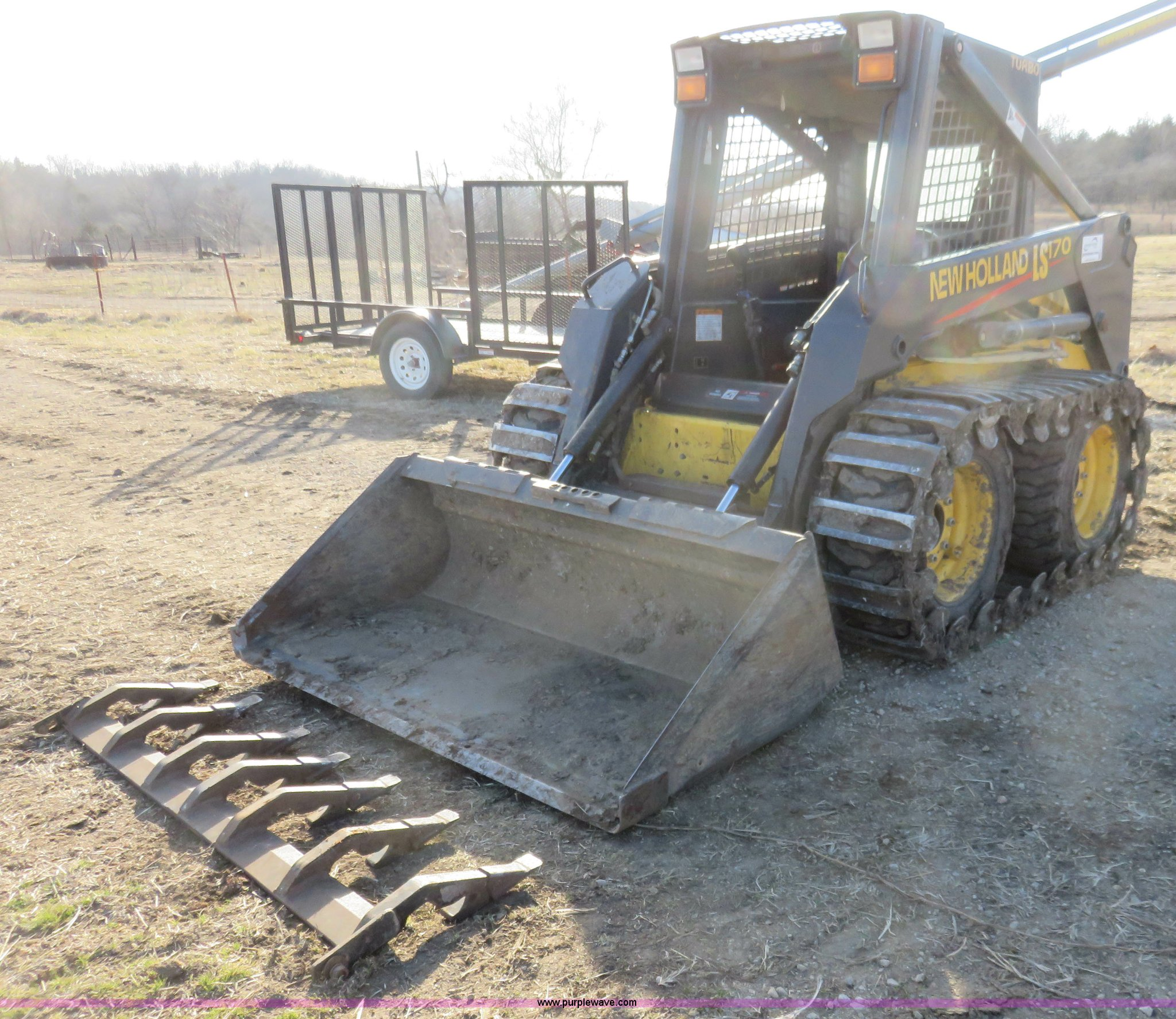 ... Holland LS170 skid steer Full size in new window ...