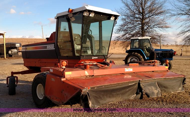 Hesston 8500 self-propelled swather | Item L6645 selling at SOLD