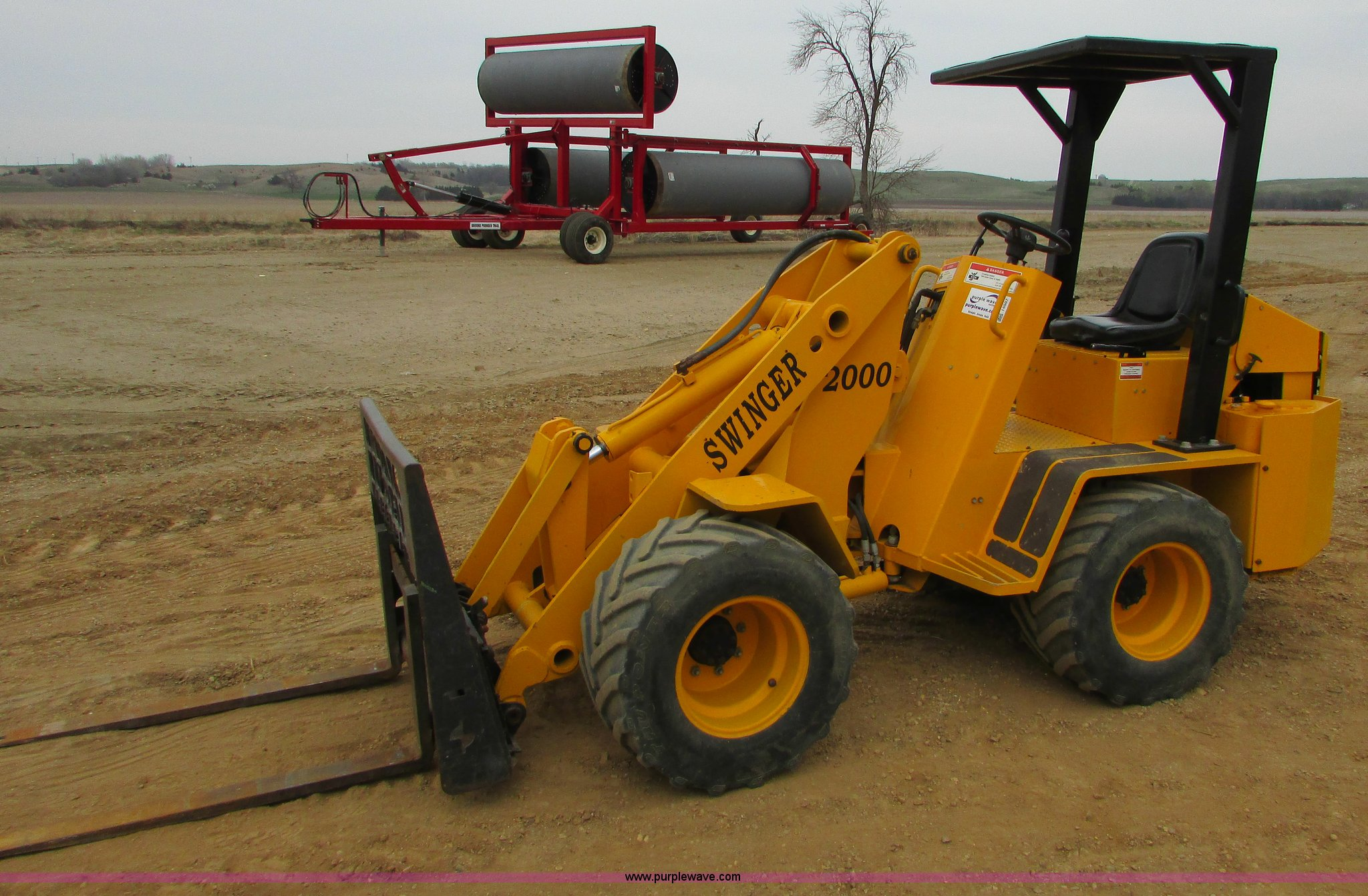 200 swinger loader