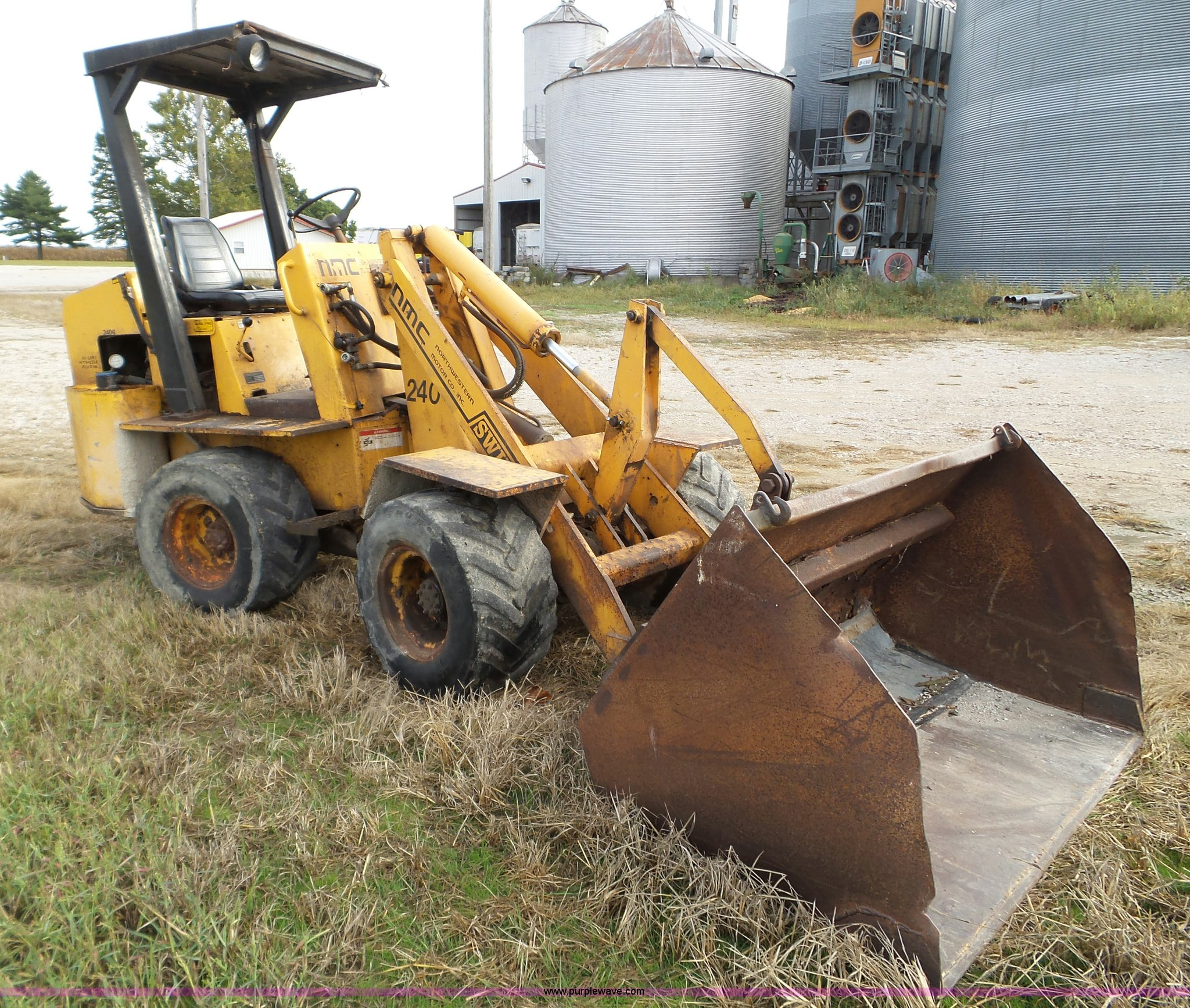 1994 NMC Swinger 240 wheel loader | Item L5036 | SOLD! Novem