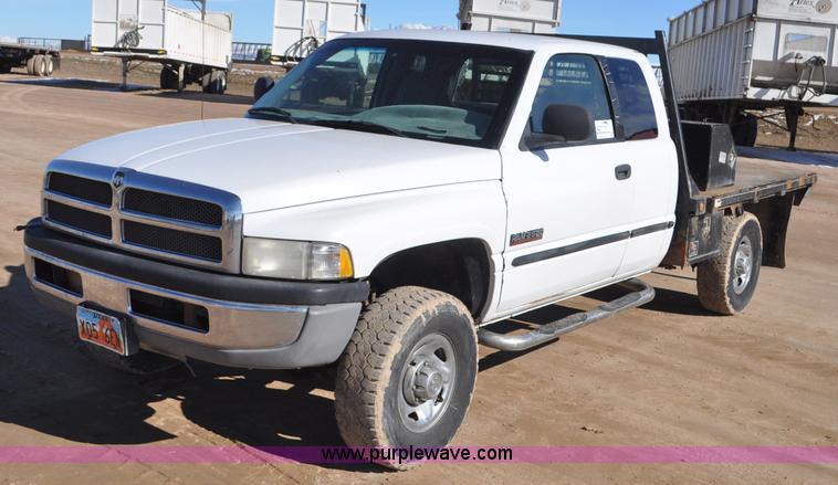1999 Dodge Ram 2500 Quad Cab flatbed pickup truck Item