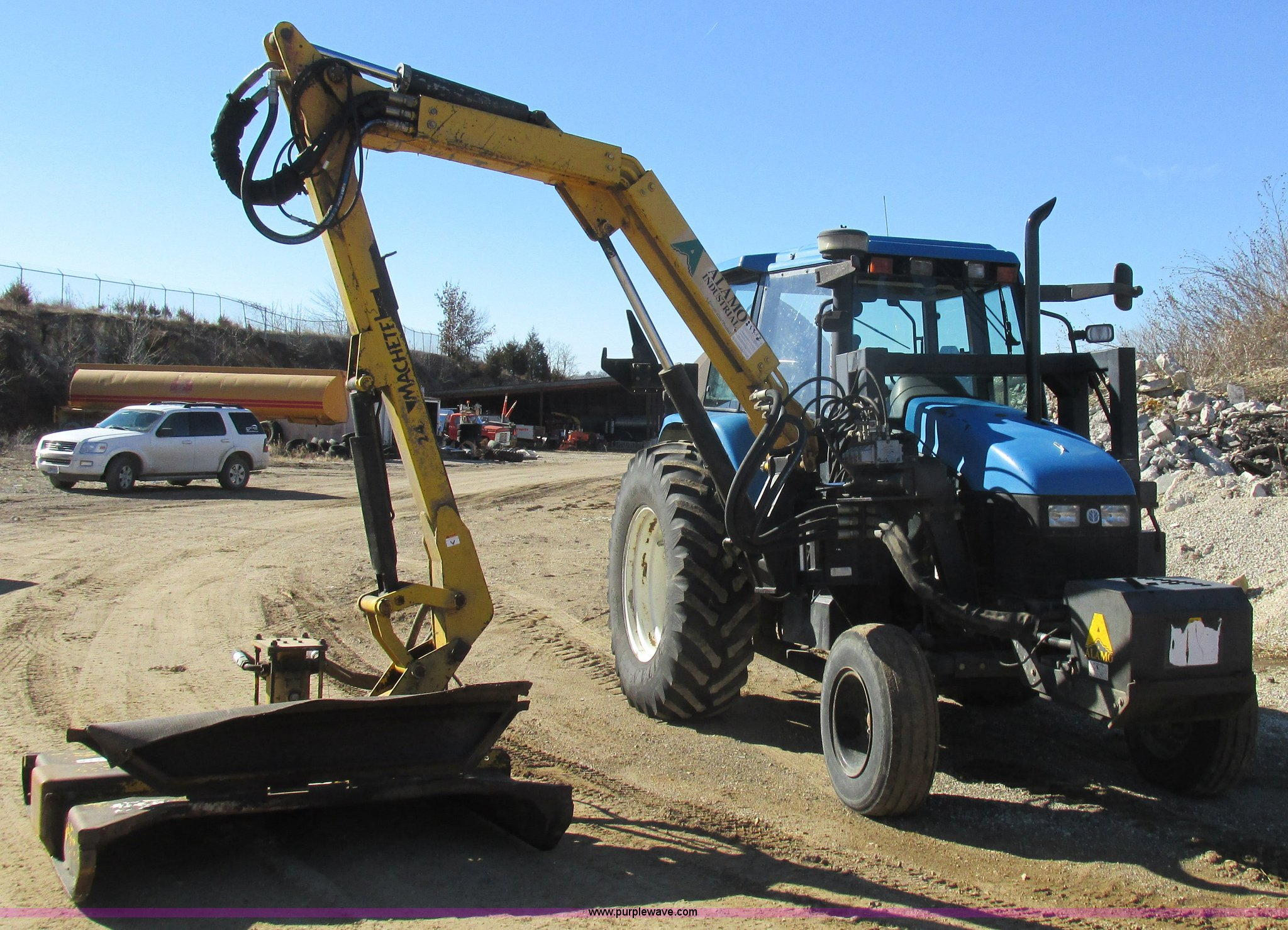 1999 Ford New Holland TS110 tractor with side boom mower | I
