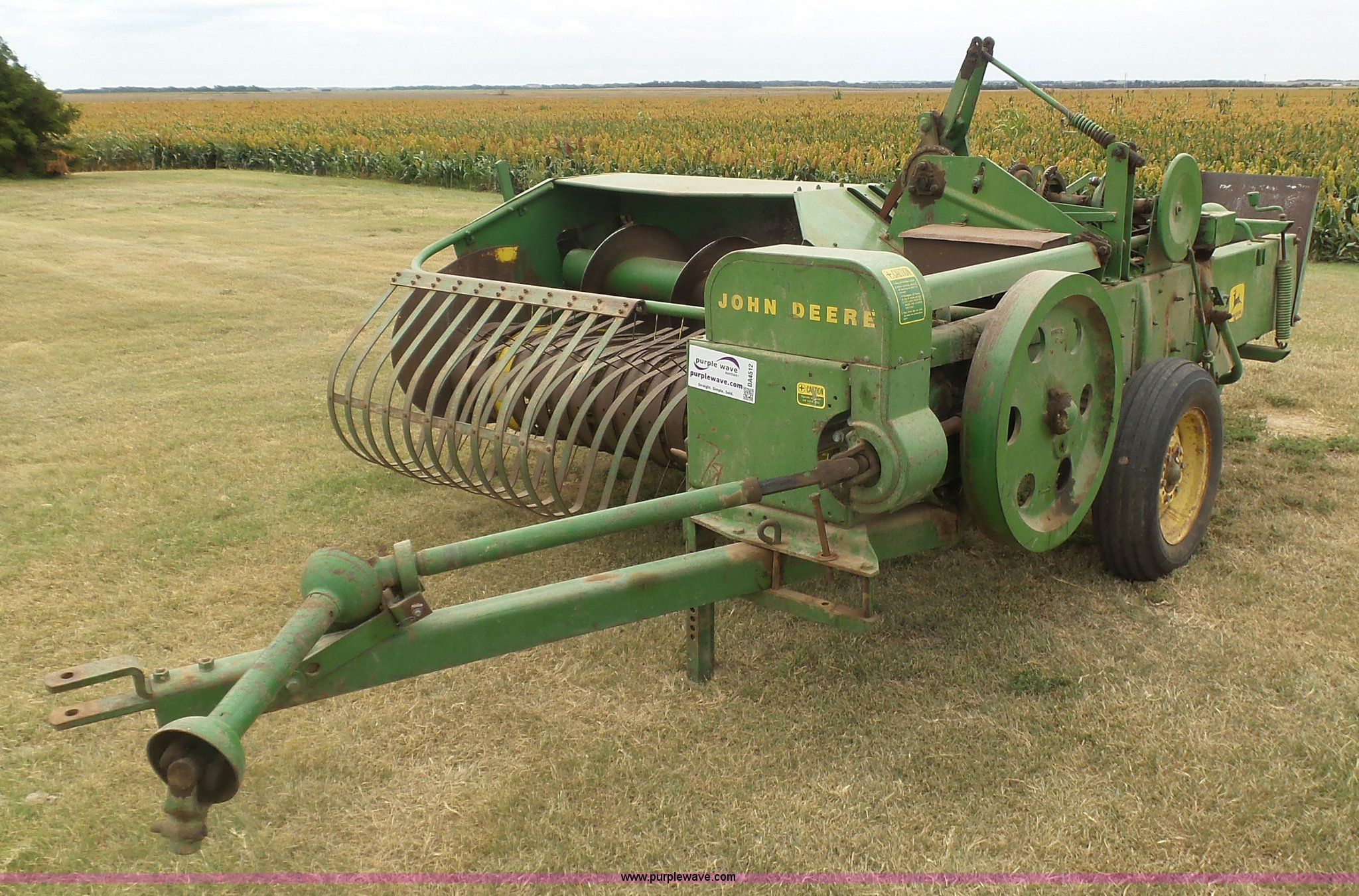 John Deere 24T small square baler | Item DA4512 | SOLD! Sept