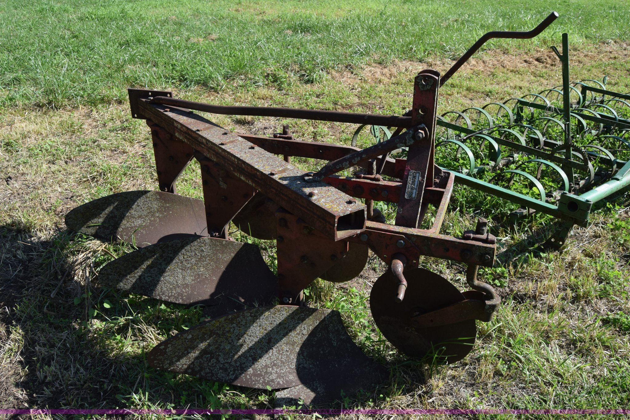 Three bottom plows for sale