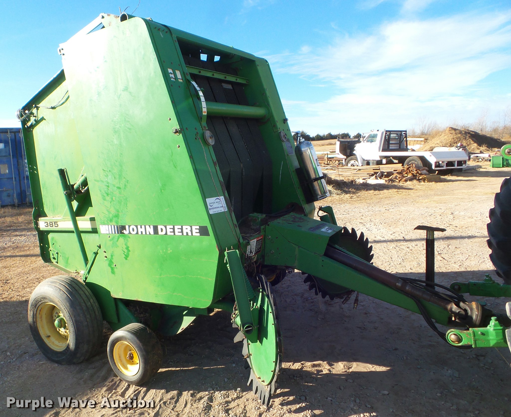 John Deere 385 round baler | Item DA7516 | SOLD! February 22