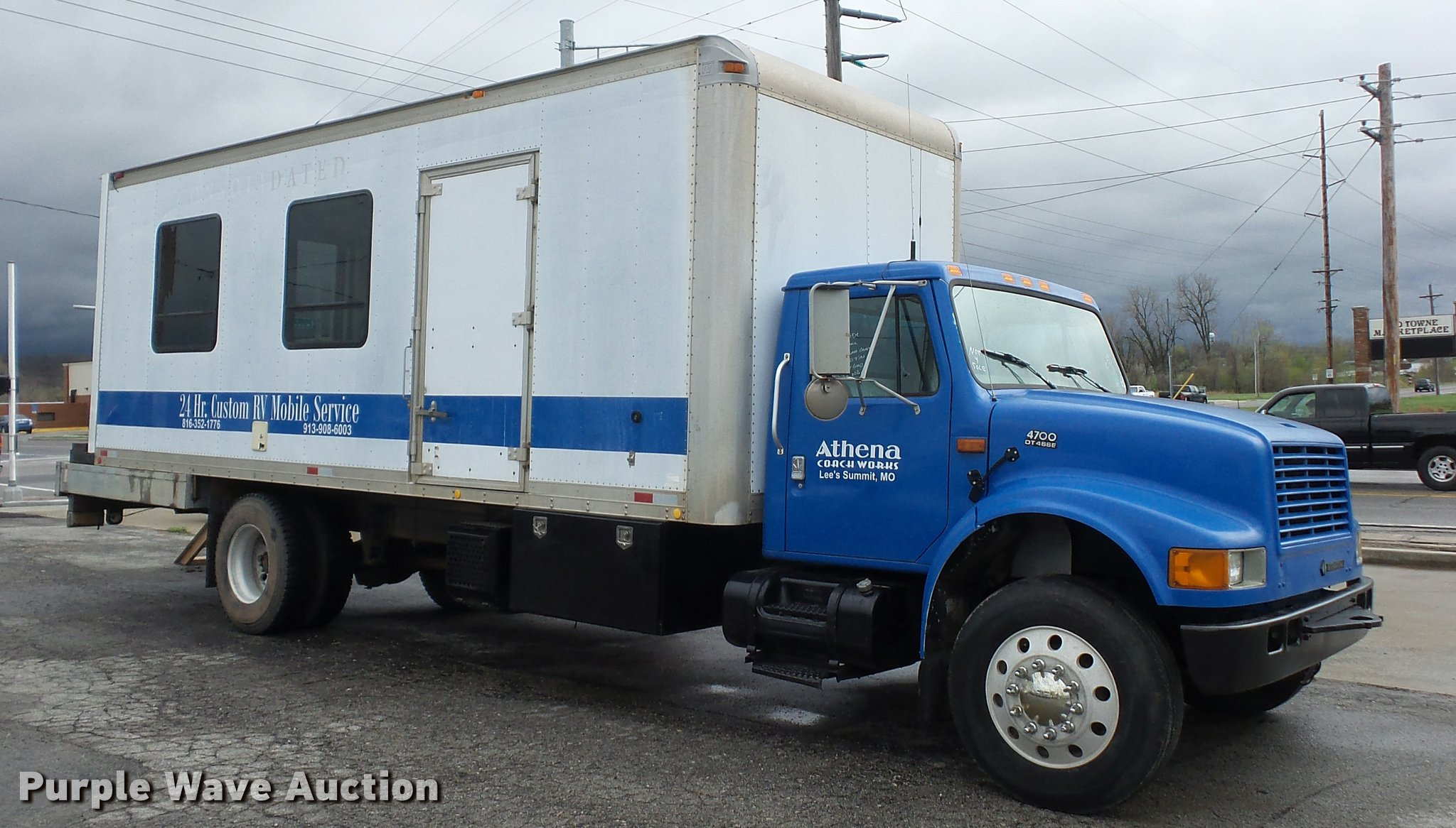 2001 International 4700 mobile office truck with generator |
