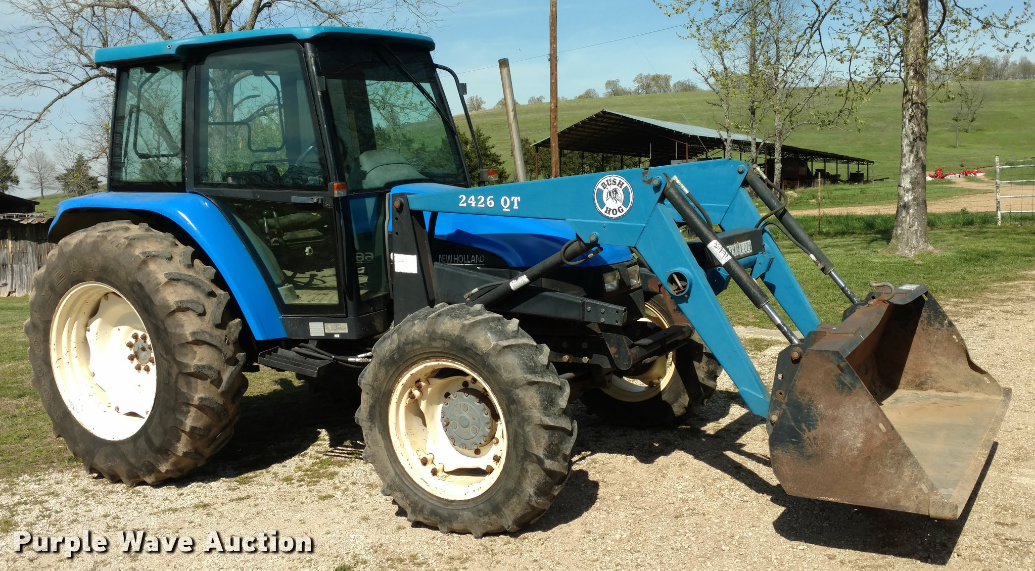 1999 New Holland 6635 tractor | Item F1842 | SOLD! May 3 Ag