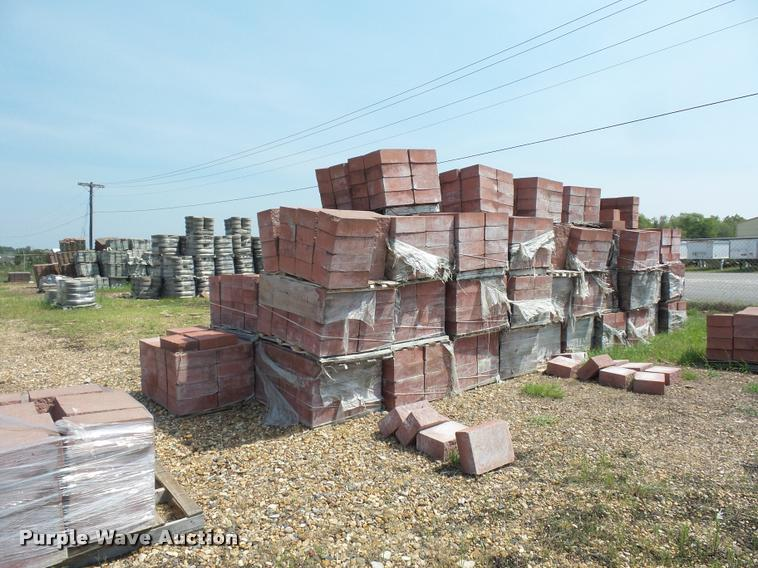 Approximately 75 pallets of retaining wall blocks in ...