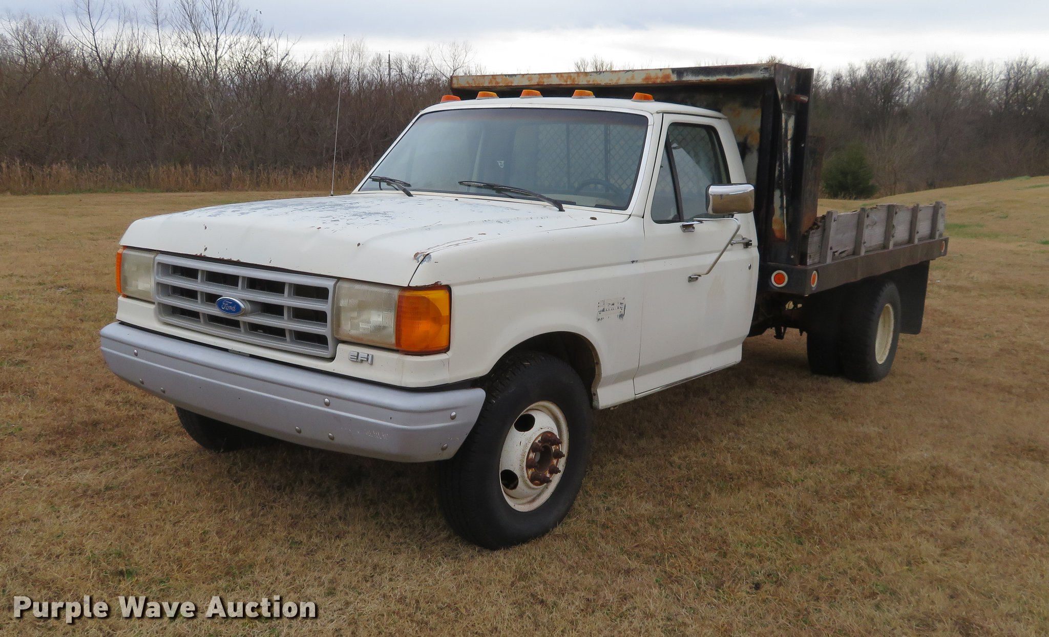 1991 Ford F350 flatbed pickup truck Item DC0775