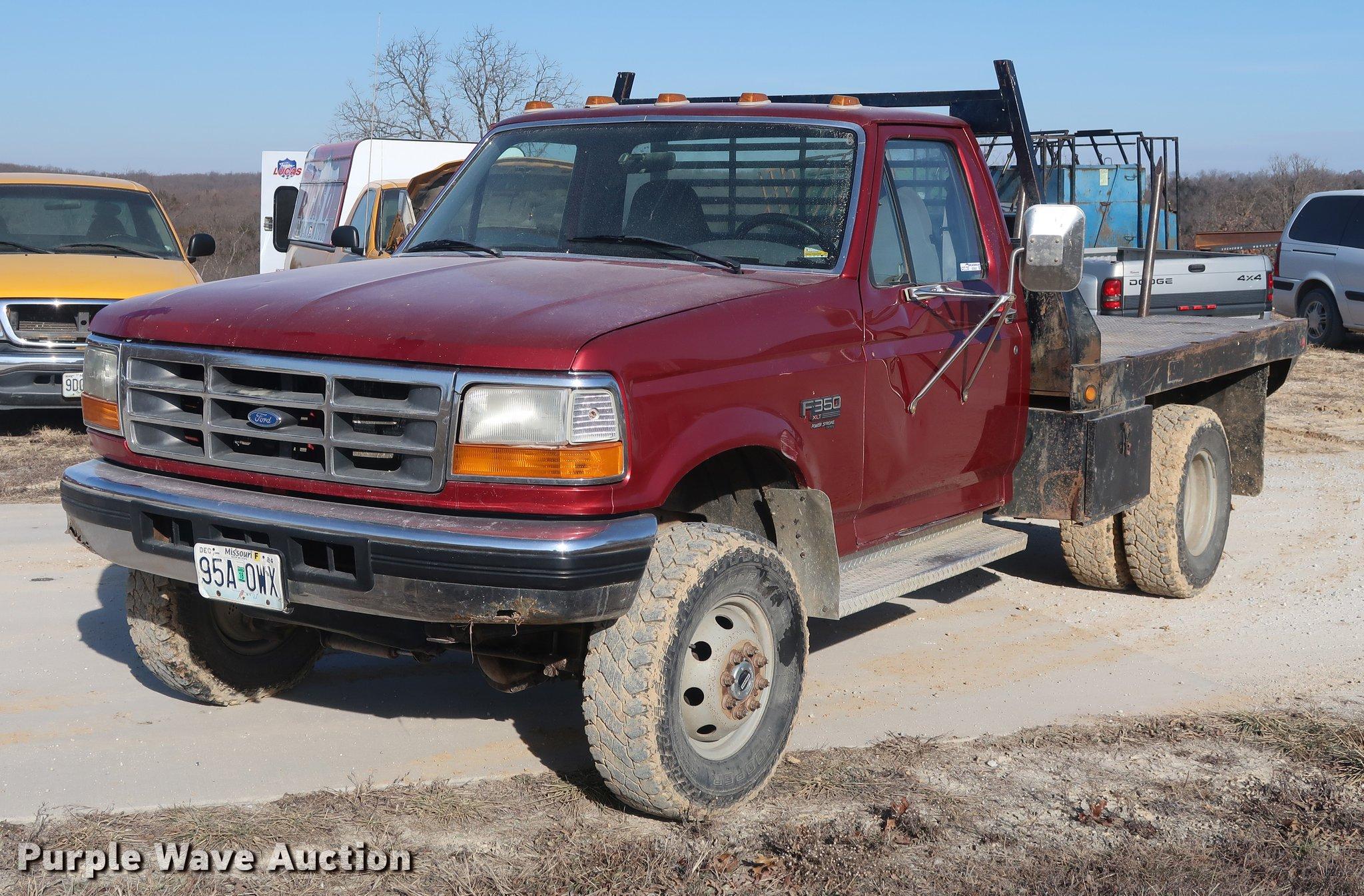 1997 Ford F350 flatbed pickup truck Item DD9557