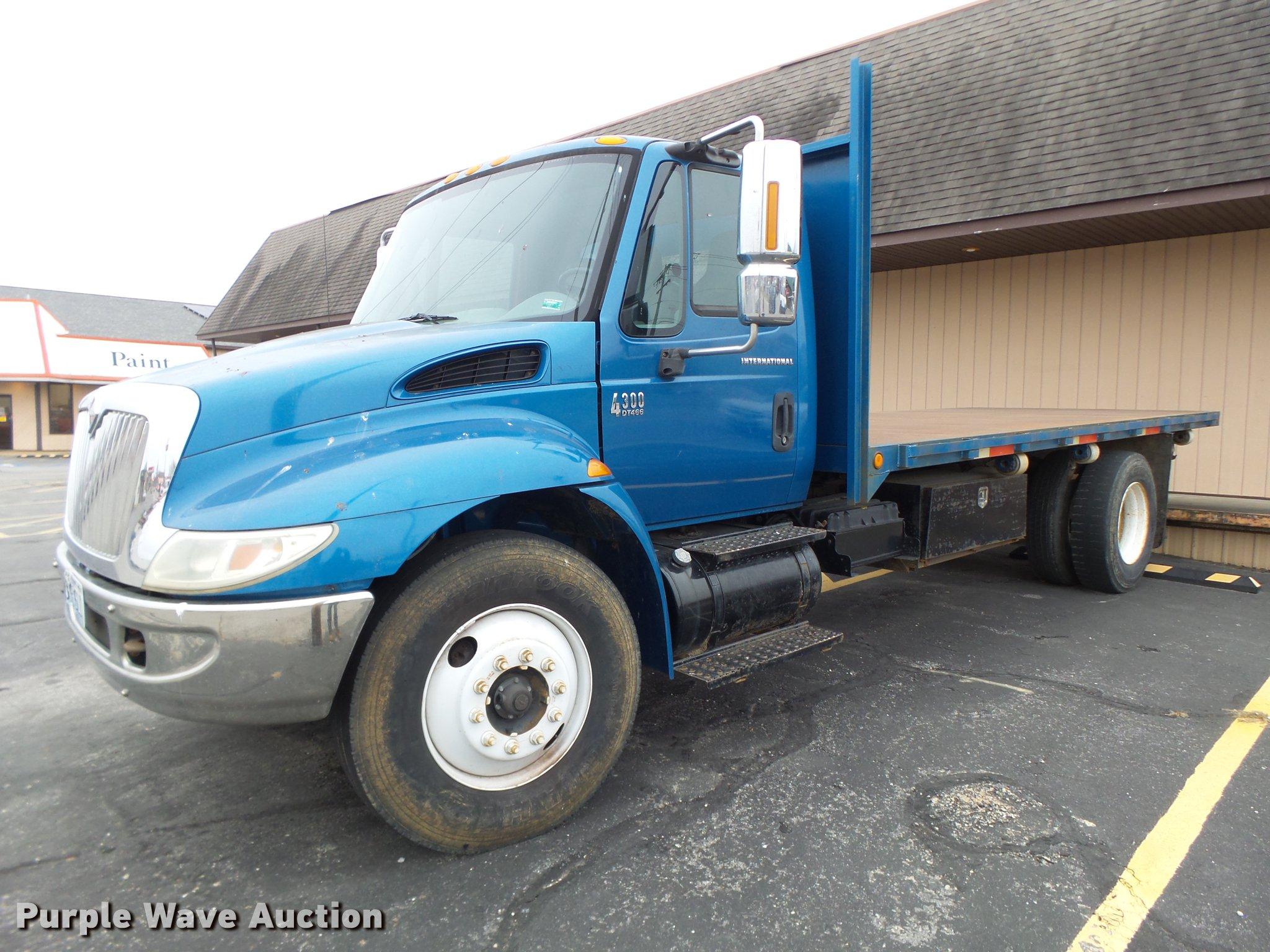 2002 International 4300 flat dump bed truck | Item DB9831 |