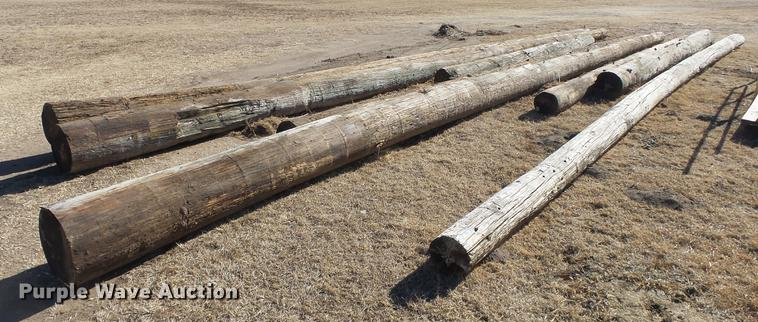 8) wood poles | Item EF9470 | SOLD! February 20 Government