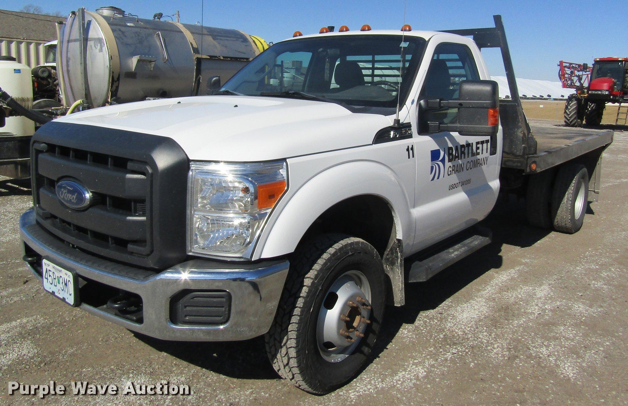 2013 Ford F350 Super Duty flatbed pickup truck