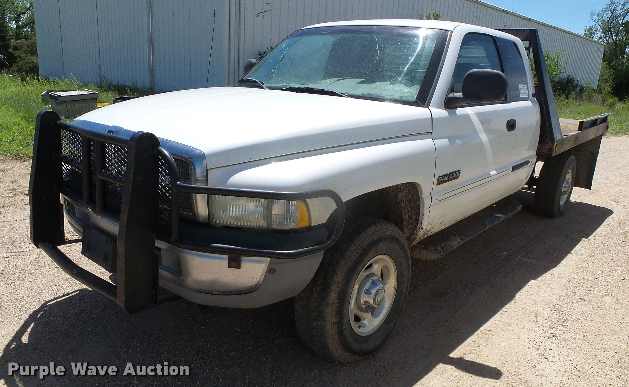 2001 Dodge Ram 2500 Laramie SLT Quad Cab flatbed pickup truc
